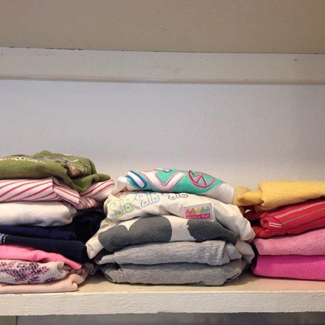 Freshly washed and folded clothing. Photo by Danila Rumold - Pyragraph