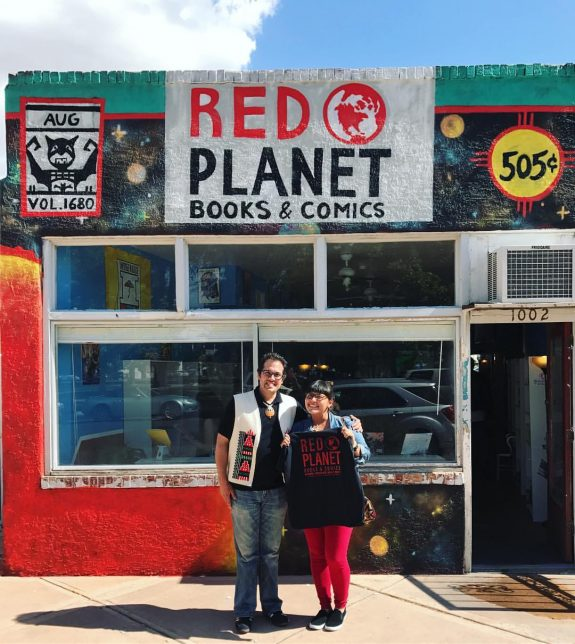 Dr. Lee Francis IV (L) with Jaclyn Roessel in front of Red Planet Books & Comics - Pyragraph
