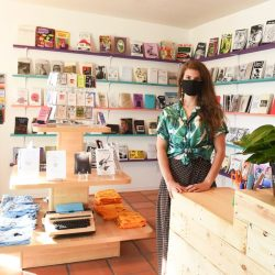 Charissa Lucille shows off Wasted Ink Zine Distro's new Phoenix location. - Pyragraph